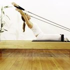 A Reformer's pulley and spring system is great for improving range of motion.