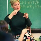 Utilize ASL and written English text in the classroom.