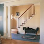 Strong color on walls with trim to match an ivory sofa punches up a room but keeps it tied together.