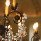 Brass and dual-sided facets on drops are clues to the chandelier's age.