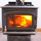 Woodstoves can keep your home cozy while cutting your heating bill.