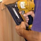 A pneumatic staple gun is effective and efficient for installing exterior trim.