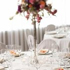 Use a long vase for dramatic centerpieces to prevent blocking guests vision.