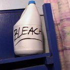Bleach will burn out unwanted plants.