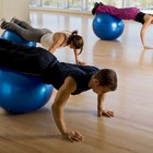 Increase the challenge of a pushup by placing a stability ball under your legs.