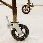 Rolling scaffold has locking wheels for safety.