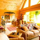 A rustic living room features large, wood-framed viewing windows.