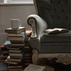 An antique chair can hold a stack of reading material.