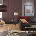 Burgundy and cream pillows liven up a charcoal couch.