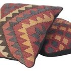 Create a southwestern theme with patterned throw pillows.