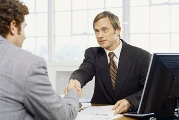 Human resource managers oversee an organization's hiring of new employees.