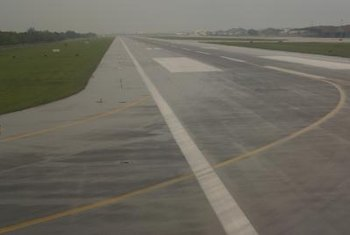 Airport managers give pilots updates on runway conditions.