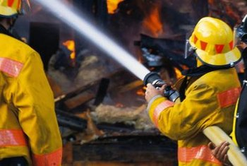 Obtain EMT certification and become physically fit to attend a firefighter academy.