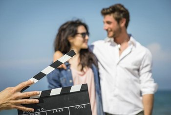 Clapboard in front of couple of actors