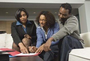 Accountant going over documents with young couple.