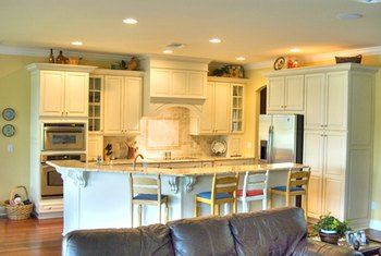 An all-white kitchen professes cleanliness.