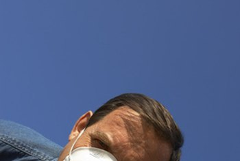 A particle respirator mask covers the nose and mouth.