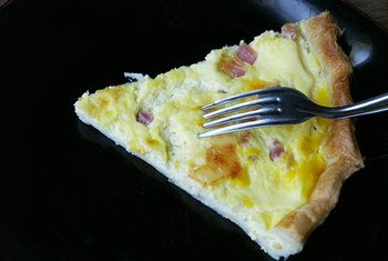 Eggs, cheese, meat and veggies make a delicious quiche.