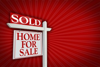 Real estate agents use signage to market homes for sale.