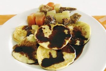 Pancakes with fruit sauce are sweet and healthy.