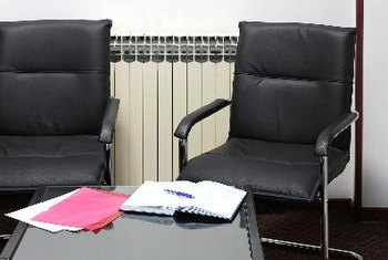 Replace plain office chairs with more comfortable seating that you might find in a home.