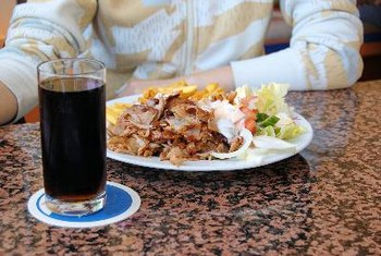 Drinking soda with a meal increases total calorie intake, which over time may cause weight gain.