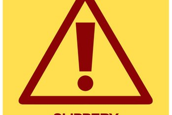 Businesses should post caution signs to warn employees of slippery surfaces.
