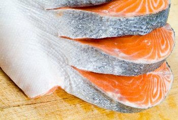 Salmon provides essential fatty acids that influence certain types of hormones.