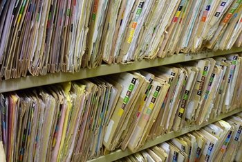 Hospital files are coded alphabetically and by date in easy-access stacks.