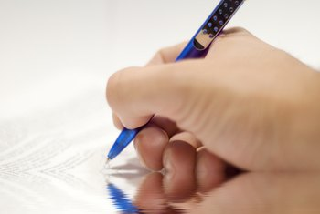 Putting pen to paper on a quitclaim deed is one tool used to convey interest in real estate.