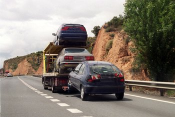 Towing away repossessed cars increases during tough economic times.