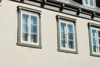 Vinyl windows can be installed in an existing stucco building.