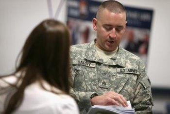 National Guard recruiters often attend job fairs to speak to potential enlistees.