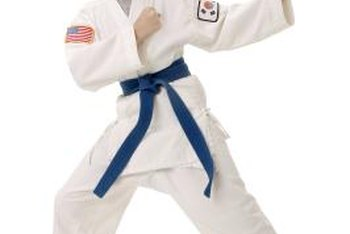 Karate instructors teach classes to both children and adults.