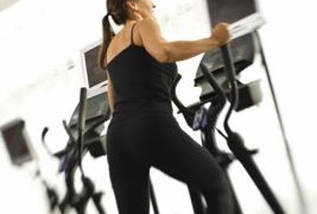 An elliptical trainer wil help to develop your legs and butt.