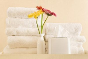 Fresh white towels and a pop of color create an easy, big-impact look.