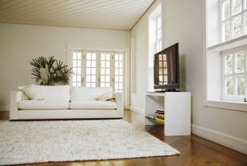 To balance your room's look, place long furniture items in front of the short walls.