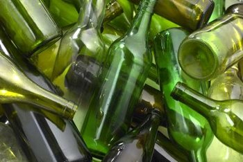 Glass bottles are a colorful, whismical fencing material.