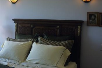 Bring an old and outdated headboard into modern times with a decorating update.