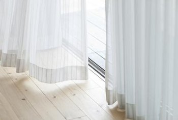 Shutters and drapes effectively regulate room light in different ways.