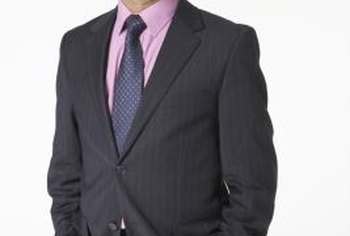Dressy business attire for men usually includes a suit and tie.