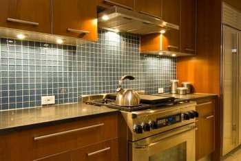 Glass is a popular backsplash material in modern kitchens.