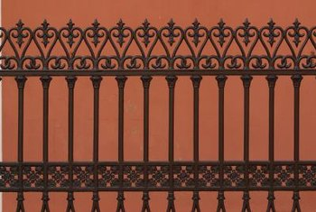 Metal fences often have elaborate ornamentation.