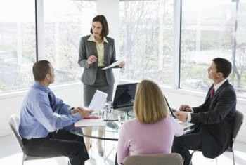 Business management consultants get a handle on problems through client meetings.