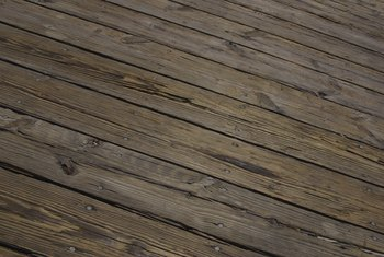Power washing and sanding can help restore an old deck surface.
