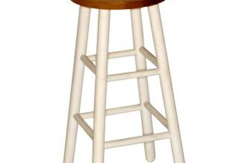 Painting a plain barstool is an inexpensive method of adding style to a room.