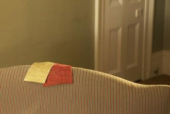 Cover your couch with new fabric to give it a new look.