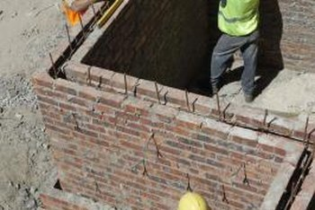 Brick masons build walls and other structures from bricks or blocks.