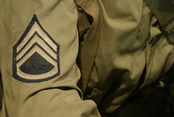 A staff sergeant (E-6) is identified by an insignia with three stripes above a shield.