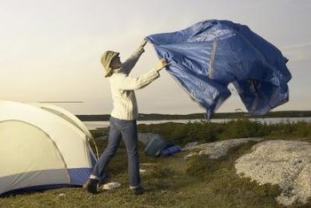 A woman inadvertently demonstrates one shortcoming of tarps.